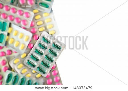 Green Oil Capsules Foil On Blurred Colorful Pills Background