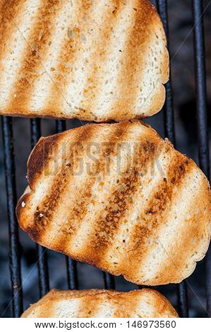 Close up of a grill with toasted bread