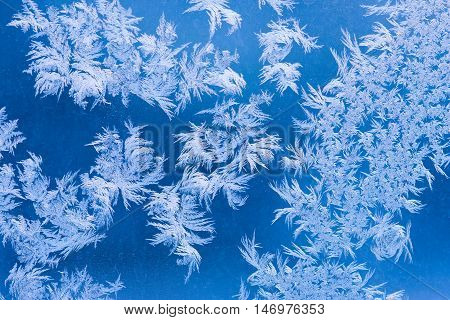 Macro shot of frosted window blue background