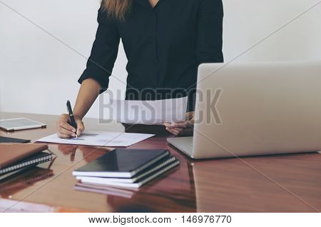 Woman Standing At Desk And Working Writing Document Hand Close Up