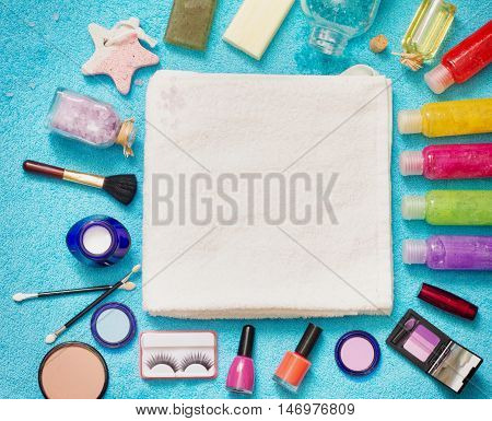 Set of cosmetics on blue towel abstract background