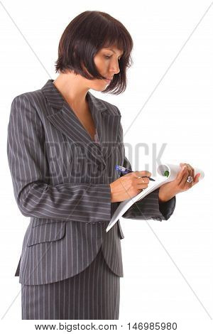 attractive business woman wrote in a notebook