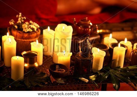 Still life with burning candles and massage herbs. Spa natural spaa still life for massage.