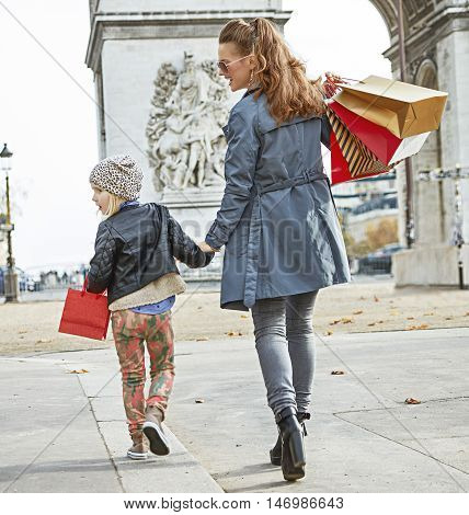 Mother And Child In Paris, France Looking Aside And Walking