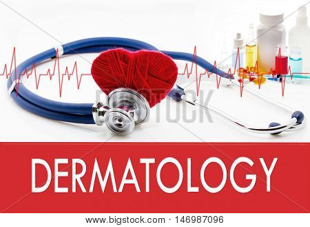 Medical concept dermatology. Stethoscope and red heart on a white background