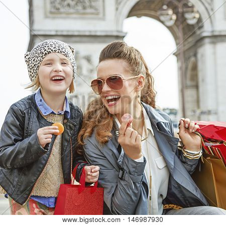 Mother And Daughter Near Arc De Triomphe Eating Macaroons