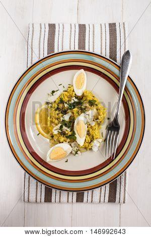 kedgeree a scottish meal with haddock basmati rice cardamom egg and lemon on a plate