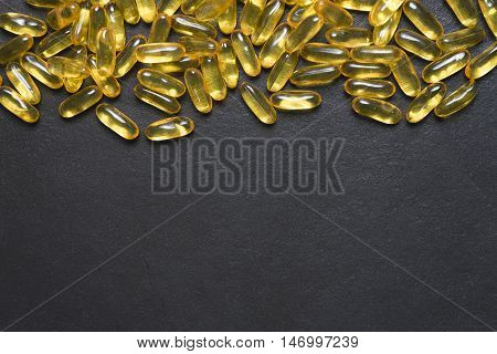 fish oil capsule on black background, healthy concept