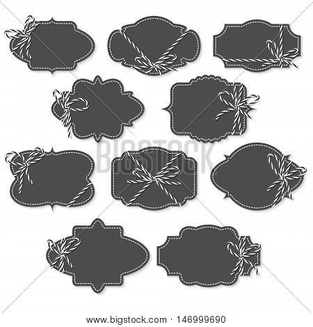 Set of chalkboard vintage labels and frames tied up with black bakers twine bows and ribbons on white background