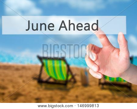 June Ahead - Hand Pressing A Button On Blurred Background Concept On Visual Screen.