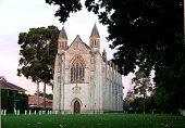 stock photo of sanctification  - chapel building peeking through branches