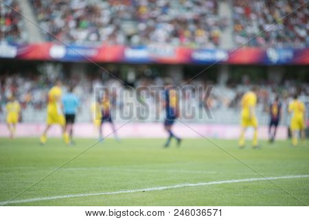 Blurred Image Of Football Players
