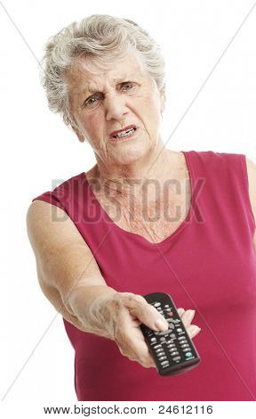 portrait of bored senior woman holding a tv control over white