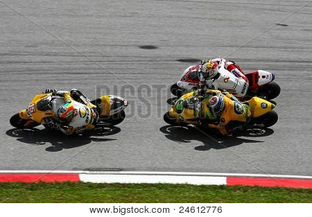 SEPANG, MALAYSIA - OCTOBER 23: Moto2 rider Alex de Angelis (15) tests his bike with others in the morning warm-up event at the Malaysian Motorcycle GP 2011 on October 23, 2011 at Sepang, Malaysia.