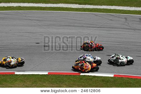 SEPANG, MALAYSIA - OCTOBER 23: Moto2 riders takes turn 15 of the Sepang International Circuit on race day of the Shell Advance Malaysian Motorcycle GP 2011 on October 23, 2011 at Sepang, Malaysia.