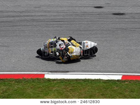 SEPANG, MALAYSIA - OCTOBER 23: Moto2 rider Thomas Luthis of Switzerland competes at the Shell Advance Malaysian Motorcycle GP 2011 on October 23, 2011 at Sepang, Malaysia. He went on to win this race.