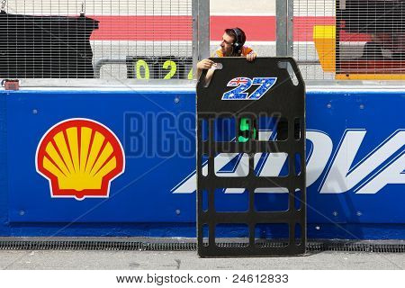 SEPANG, MALAYSIA - OCTOBER 21: A staff of Casey Stoner sends a message from side of the track during free practice on Day 1 of the Malaysian Motorcycle GP 2011 on October 21, 2011 at Sepang, Malaysia.