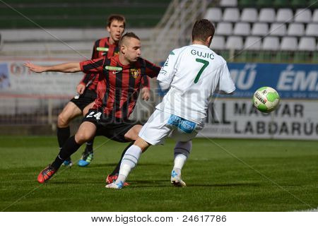 KAPOSVAR, HUNGARY - OCTOBER 15:Boris Gujic (in white) in action a Hungarian National Championship soccer game - Kaposvar (white) vs Honved (red) on October 15, 2011 in Kaposvar, Hungary.