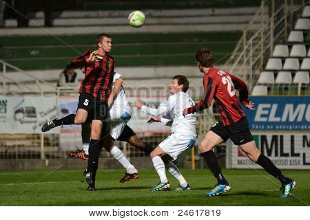 KAPOSVAR, HUNGARY - OCTOBER 15: Milan Peric (in white) in action a Hungarian National Championship soccer game - Kaposvar (white) vs Honved (red) on October 15, 2011 in Kaposvar, Hungary.