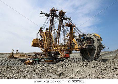 Huge Yellow Overbuden Excavator In Brown Coal Mine