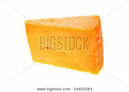 piece of cheddar cheese isolated on a white background
