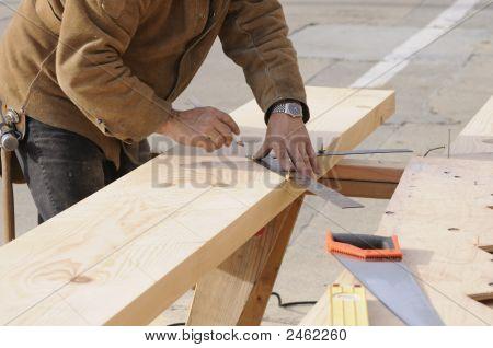 Carpenter Marking Out Steps On A Stringer