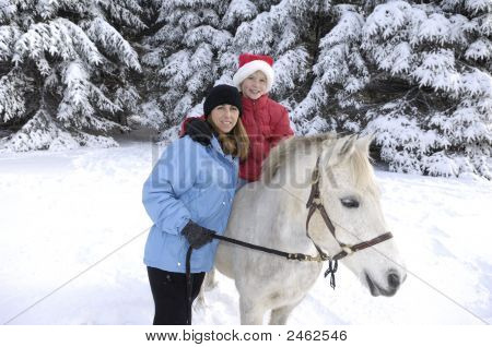 Mother And Daughter With Pony.