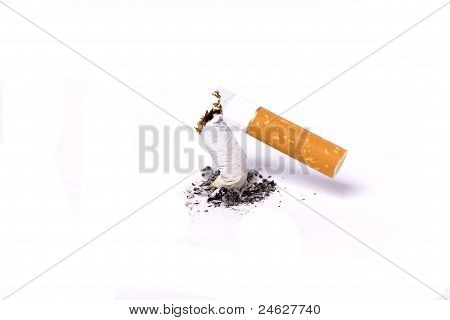 A Single Broken Cigarette Butts And Ash