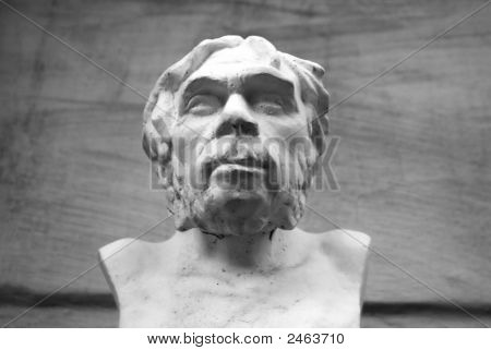 Black And White Sculpture Of Ancient Man