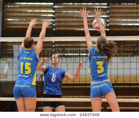 KAPOSVAR, HUNGARY - OCTOBER 2: Zsofia Harmath (3) in action at a Hungarian NB I. League volleyball game Kaposvar (yellow number) vs Tatabanya (white number), October 2, 2011 in Kaposvar, Hungary.