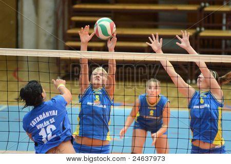 KAPOSVAR, HUNGARY - OCTOBER 2: Kamilla Gyorbiro (6) in action at a Hungarian NB I. League volleyball game Kaposvar (yellow number) vs Tatabanya (white number), October 2, 2011 in Kaposvar, Hungary.