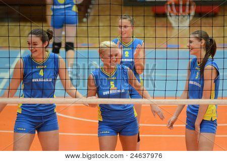 KAPOSVAR, HUNGARY - OCTOBER 2: Kaposvar players at a Hungarian NB I. League volleyball game Kaposvar (yellow number) vs Tatabanya (white number), October 2, 2011 in Kaposvar, Hungary.