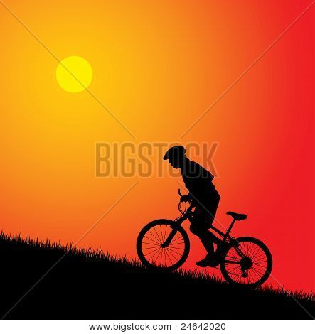 Biker silhoutte on the sunset