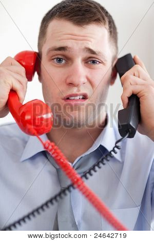 Close up businessman overextended with the telephone