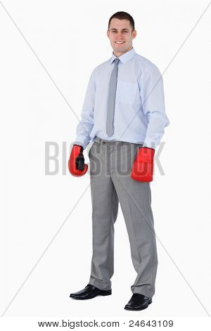Smiling businessman ready for tough negotiation on white background