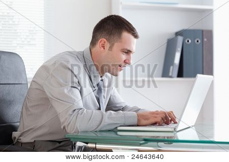 Young businessman working concentrated on his laptop