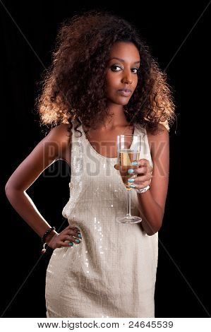 Young Beautiful African Woman Holding A Glass Of Champagne