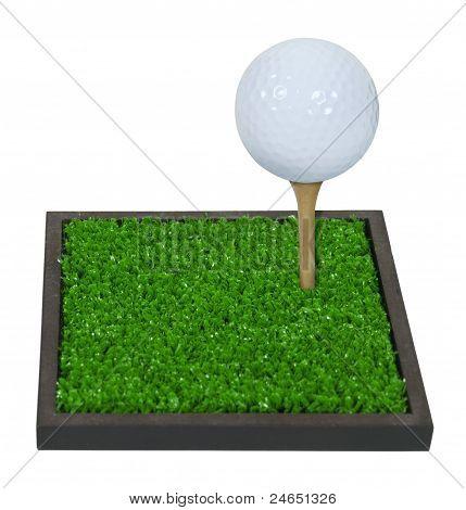 Golf Ball On A Tee On Green Grass
