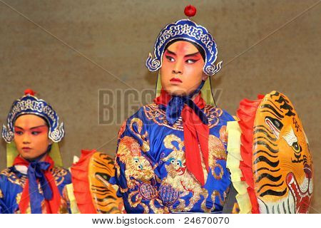 BEIJING, CHINA - NOVEMBER 16: Artists acting as soldiers perform a Peking opera show on November 16, 2005 in Beijing, China. The story depicts heroic battles fought in ancient China.