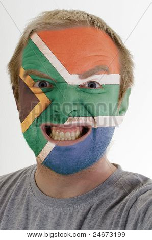 Face Of Crazy Angry Man Painted In Colors Of South Africa Flag