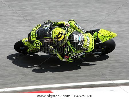 SEPANG, MALAYSIA - OCTOBER 23: Moto2 rider Andrea Iannone warms up on race day of the Shell Advance Malaysian Motorcycle Grand Prix 2011 on October 23, 2011 at Sepang International Circuit, Malaysia.