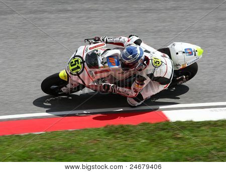 SEPANG, MALAYSIA - OCTOBER 23: Moto2 rider Michele Pirro warms up on race day of the Shell Advance Malaysian Motorcycle Grand Prix 2011 on October 23, 2011 at Sepang International Circuit, Malaysia.