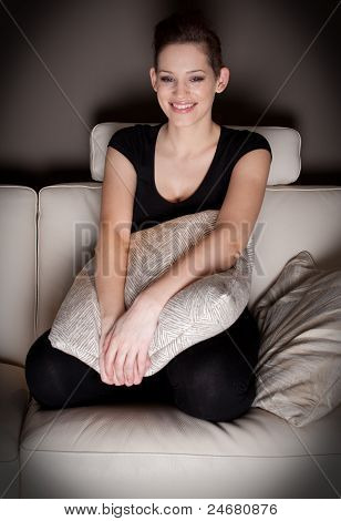 An Attractive Young Woman Watching Tv