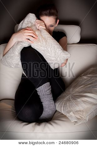 Beautiful Young Woman Watching A Horror Movie Alone