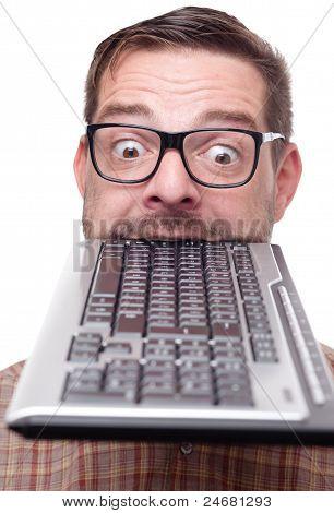 Geek Biting Into A Keyboard