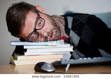 Tired Nerd Falling Asleep On A Bunch Of Books
