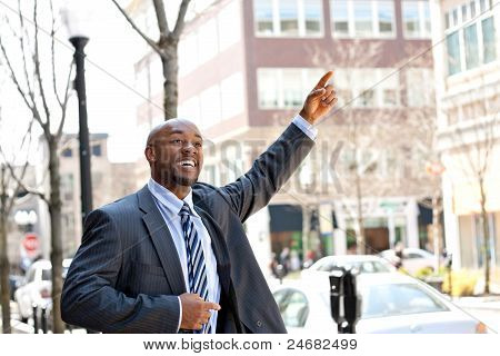 Business Man Hails A Taxi