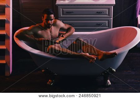 Guy In Bathroom With Furniture