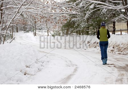 Walking On A Snowy Road