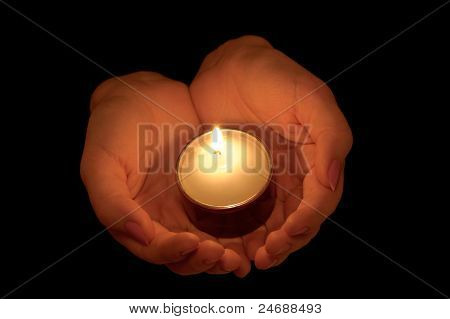 Burning Candle In Female Hands